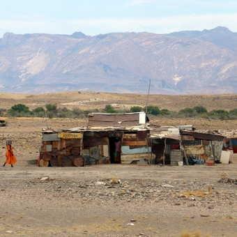 Naftalina Mauha: Herero lady who runs an orphanage in her small home.