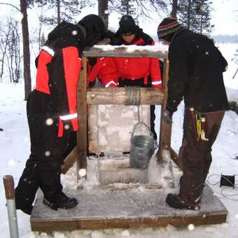 Drawing water from a frozen well