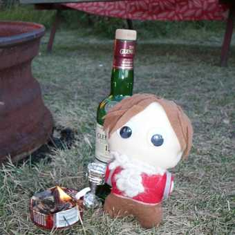 Munro having a dram by his camp fire!