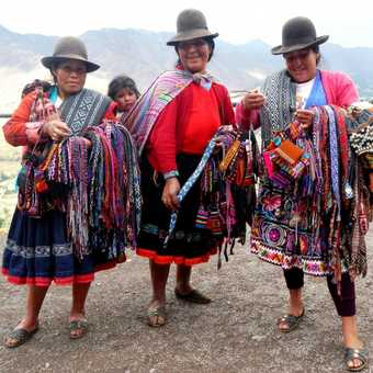 Pisac's most colourful women . . . and child.