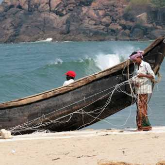 Mending fishing nets at Kovalam, Kerala
