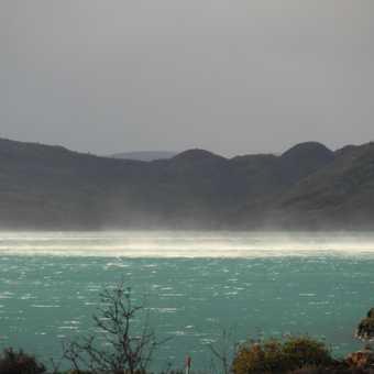 Spray lifted off lake beside Camino de los Vientos