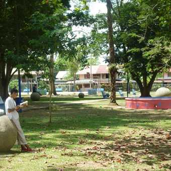 Mike gets stoned - in the park at Palmar Sur, on our way to Golfito
