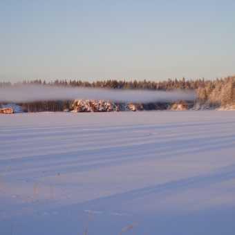 Mist over frozen lake