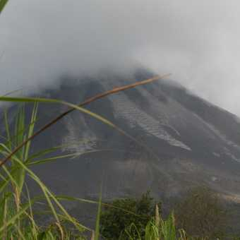Arenal Volcano with its top covered in cloud