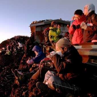 Crowds of trekkers at sunrise on Mount Fuji