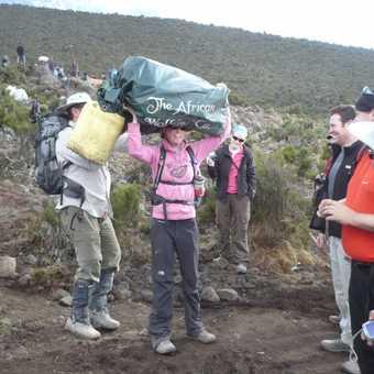 Post-trek team photo on return to the Kilimanjaro Mountain Lodge