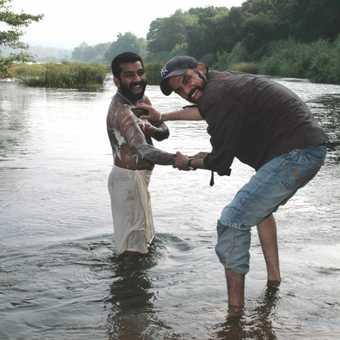 Washing mahout at Kodanadu, Kerala