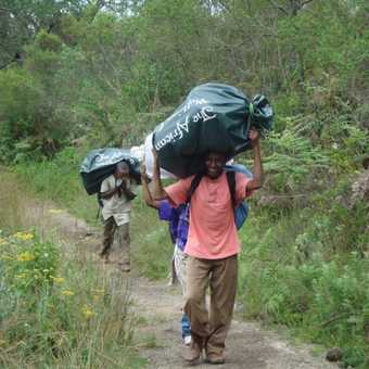 Porters, carrying our wordly goods, accompany us along the way