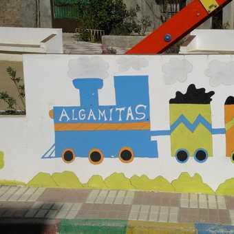 Colourful sign at village entrance