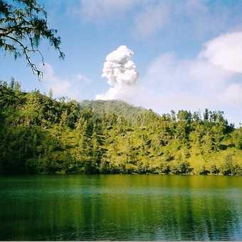Ranu Kumbolo with the smoke billowing top of Mt. Semeru. Ranu is lake.