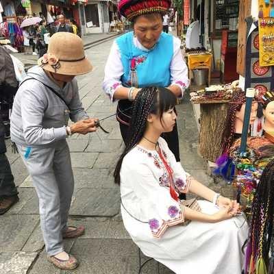 Girl in traditional dress, Bai ethnic group, Dali, Yunnan, China