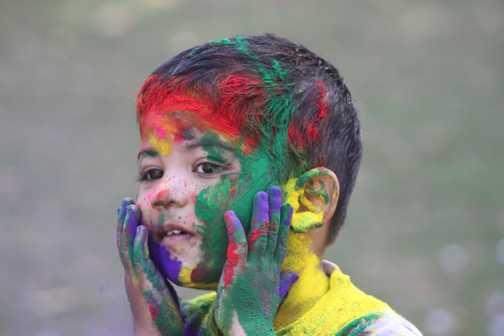 Young boy enjoying Holi Festival