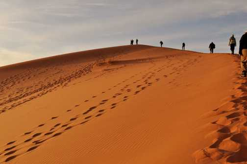 Climbing to the top of the dune in time for sunset