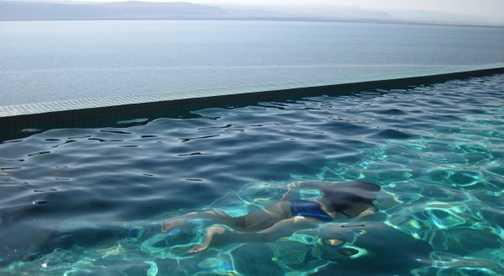 Underwater in Dead Sea resort inginity pool overlooking the Dead Sea