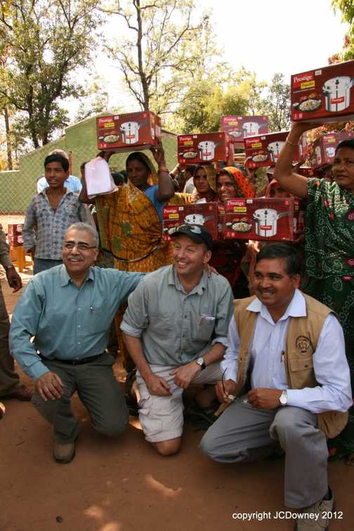 Paul, Mohan and the Park Director - with the ladies and their pressure cookers