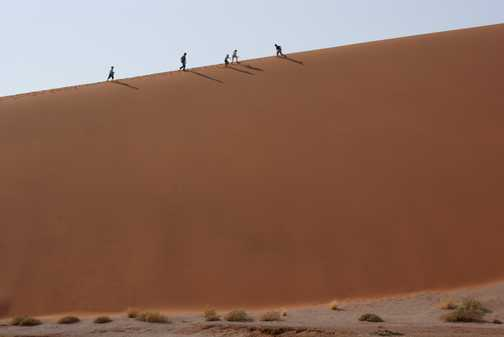 Children climbing the dunes