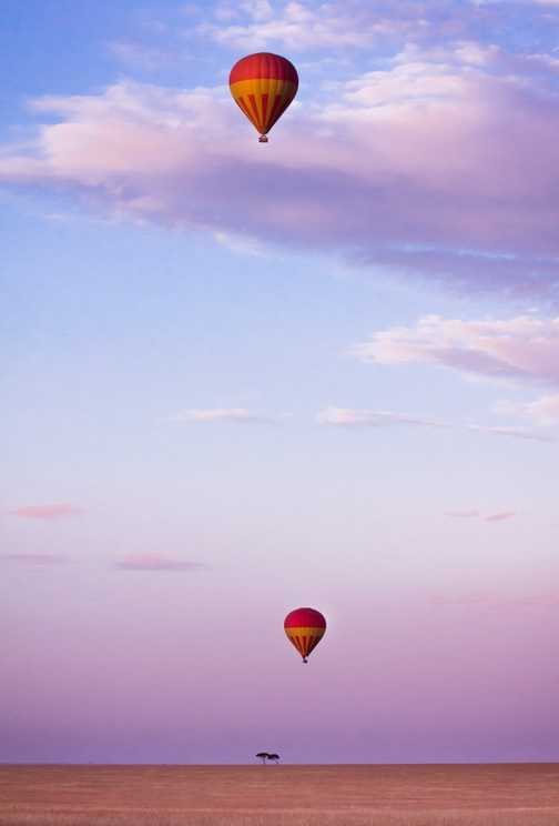 Balloons rising up early in the morning - Masai Mara