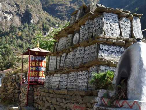 Mani stones and prayer wheel