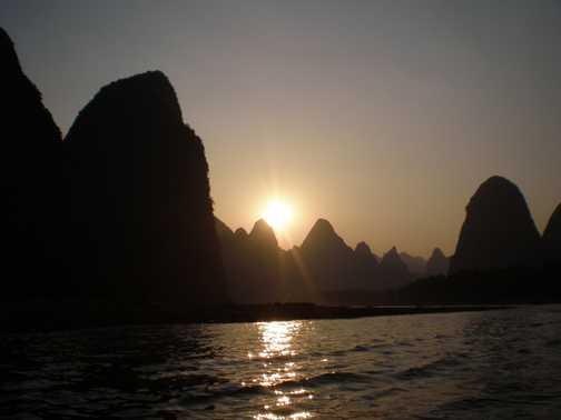 Sunset bamboo rafting