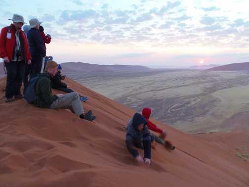 Watching sunrise from Kalahari dune