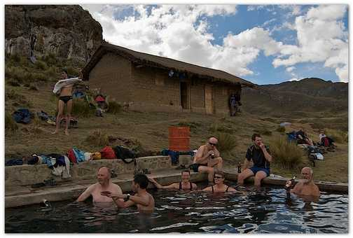 Boys and gals having fun and booze at the hot springs