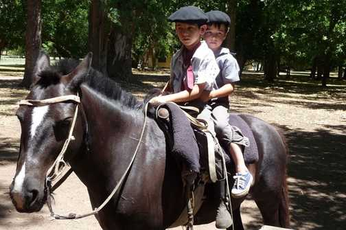 Little gauchos on horseback