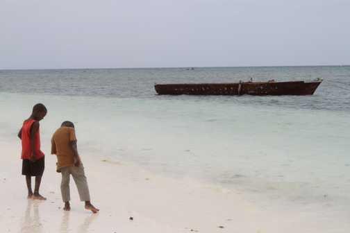 local boys looking for shells - Zanzibar