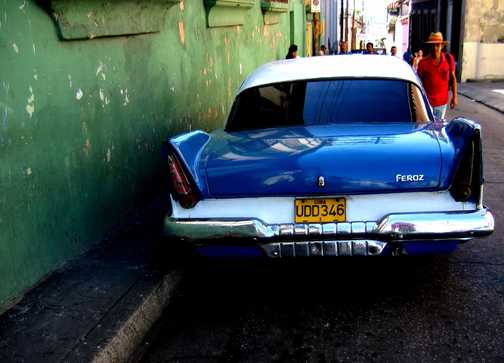 blue car, red shirt