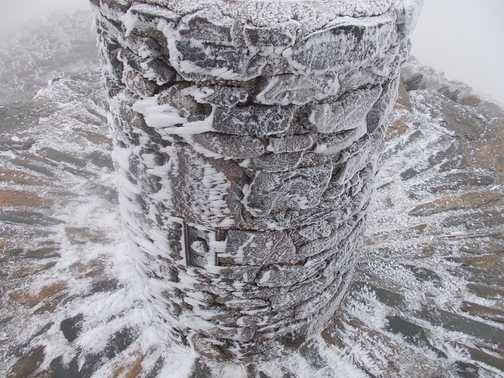Ice covered summit post