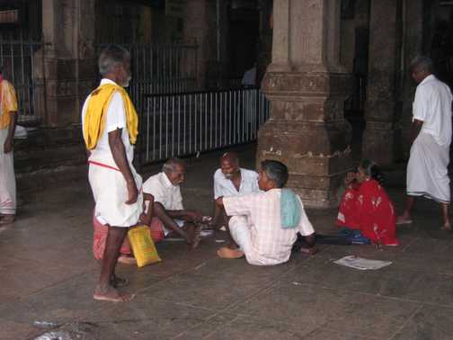 Relatives in temple arranging a marriage