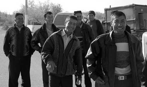 Uzbek men on the Amu Darya River Crossing