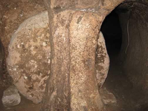Stone door at underground city