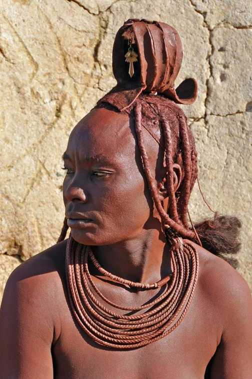 Himba woman wearing traditional headdress