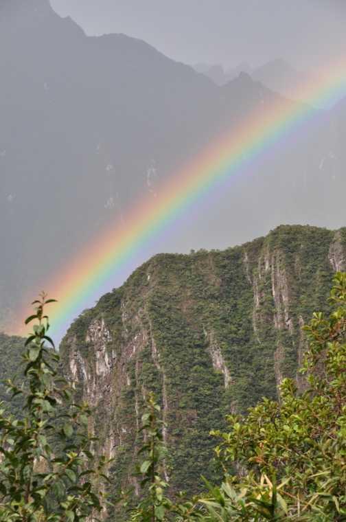 striking rainbow from the sungate at machu picchu