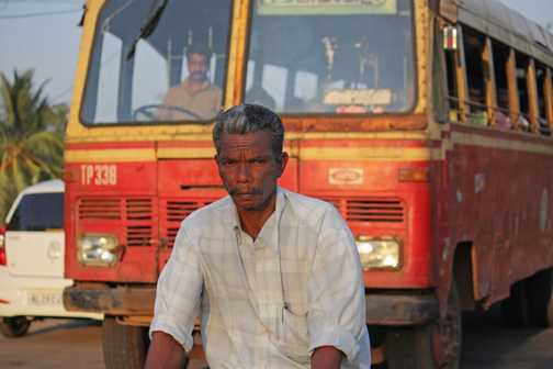 A worker takes a break at Cochin Laundry