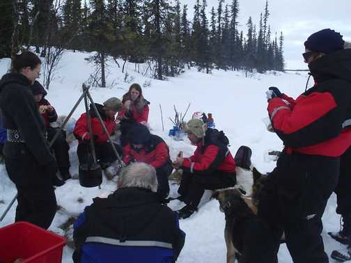 Warming lakeside campfire lunch on cross-country ski trip