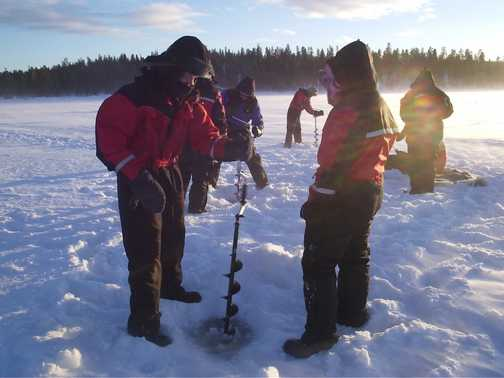 Drilling ice for fishing (no-one caught anything after all that work)