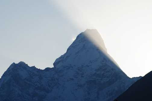 Ama Dablam in early mornig shafting sunlight - at Tengbouche
