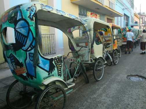 BICITAXIS ... READY TO TAKE US ON A TOUR OF CAMAGUEY