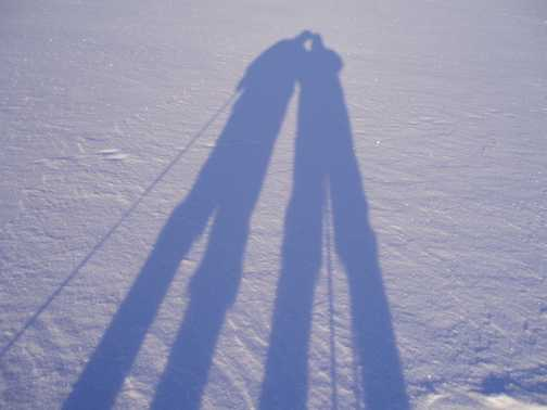 Our shadows on frozen lake