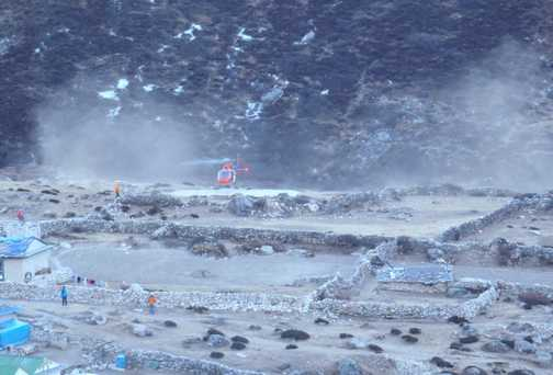 A rescue helicopter landing at Dingboche