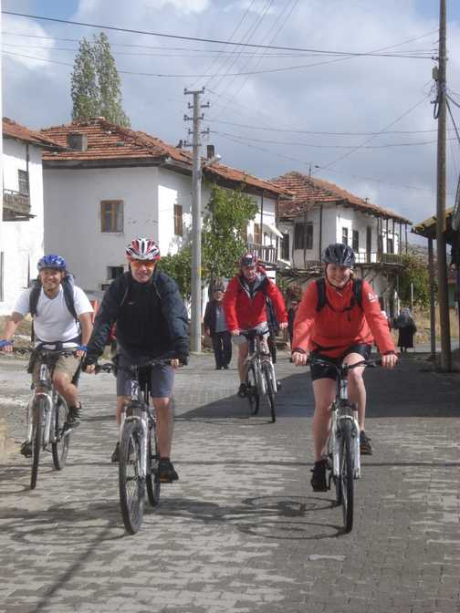 Cyclists in village