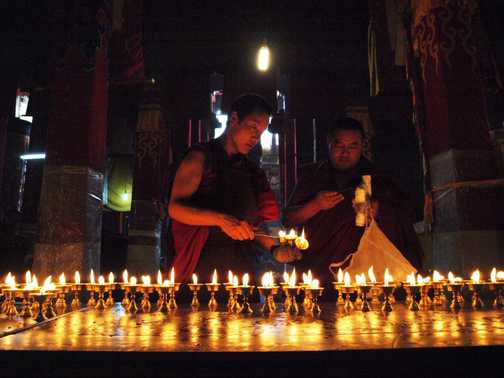 Lighting the butter lamps