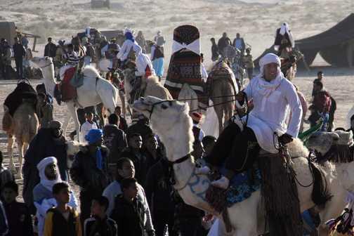 Camel riders strutting their stuff