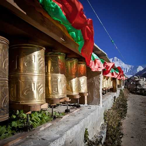 Nun preparing yak butter candles, Rongbuk Monastery