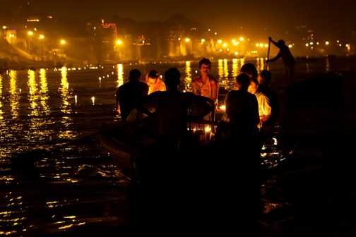 Returning along the Ganges after the end of the evening prayers