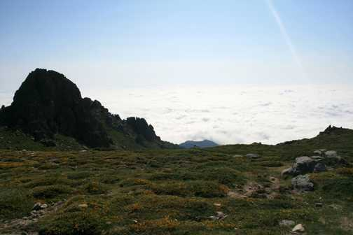 Above the clouds heading towards the Arete a Monda