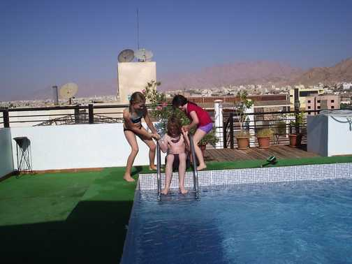 Kids play at rooftop pool in Aqaba