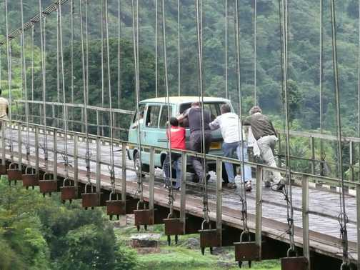Giving a helping hand to a local across one of the many suspension bridges